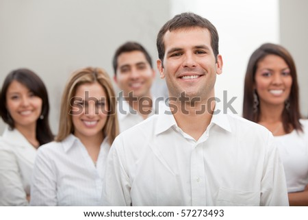 Group of business people at the office smiling - stock photo