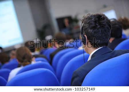 Group of business people attending press conference or presentation. - stock photo