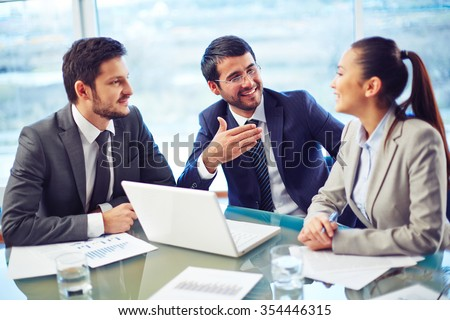 Group of business people brainstorming together in the meeting - stock photo