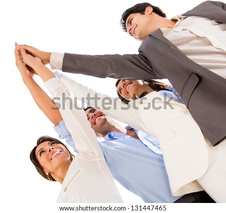 Group of business people celebrating their teamwork with a high five - stock photo