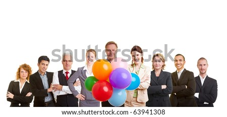 Group of business people celebrating with many balloons - stock photo
