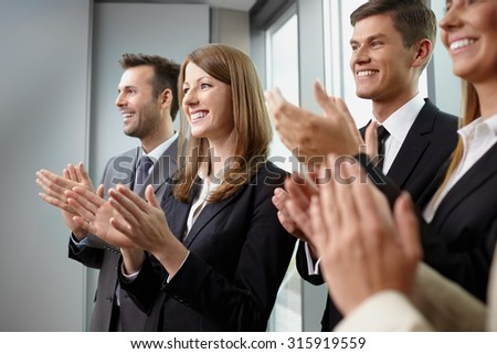 Group of business people clapping hands. Business seminar concept - stock photo