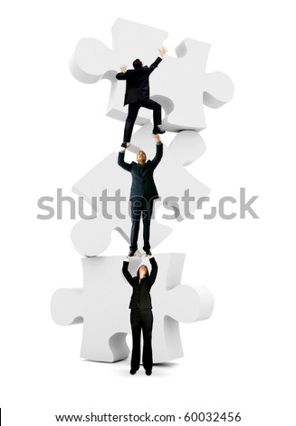 Group of business people climbing on the pieces of a puzzle - isolated - stock photo