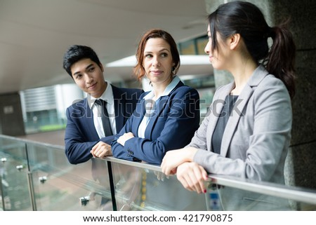 Group of business people discuss out of office