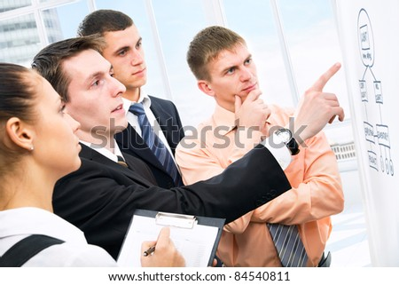 Group of business people discussing a new project in the office - stock photo