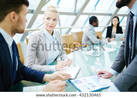 Group of business people discussing at the table during a meeting - stock photo