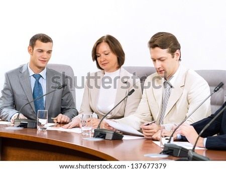 group of business people discussing documents, teamwork - stock photo