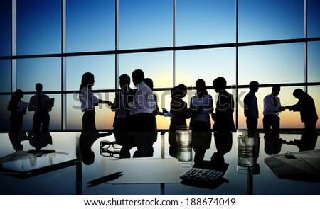 Group of business people discussing in a conference room. - stock photo
