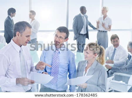 Group of Business People Discussing in Office - stock photo
