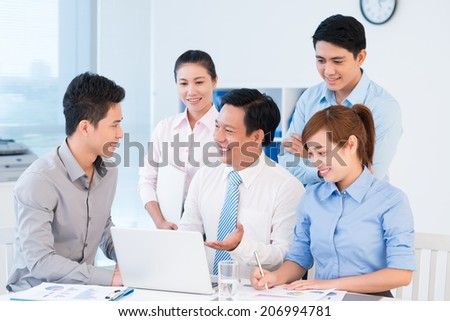 Group of business people discussing project in the office - stock photo
