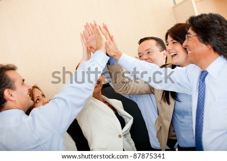 Group of business people giving a high-five - stock photo