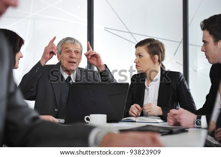 Group of business people having a discussion in office - stock photo