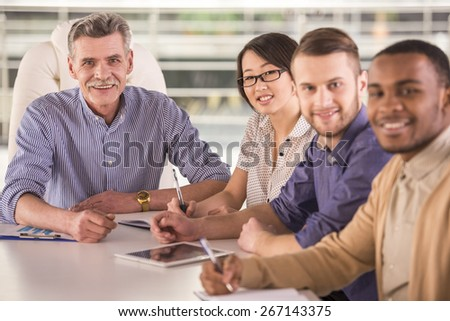 Group of business people having meeting in office. - stock photo