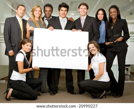 group of business people holding a banner add in an office - stock photo