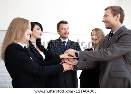 Group of business people holding hands