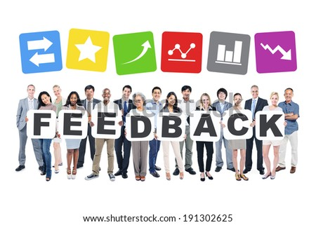 Group Of Business People Holding The Word Feedback And Related Symbols Above - stock photo