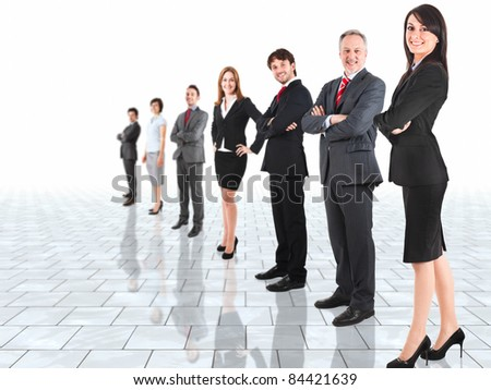 Group of business people in a bright room - stock photo