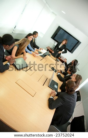 Group of business people in a conference room - stock photo