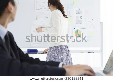 Group of business people in a meeting at office - stock photo