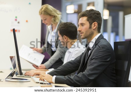 Group of business people in a meeting at office, working on computer - stock photo
