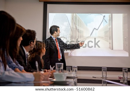 Group of business people in a meeting at the office - stock photo