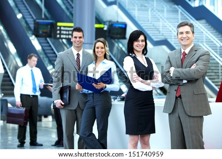 Group of business people in a modern hall. Meeting. - stock photo