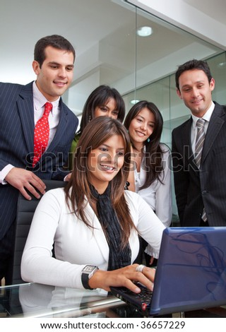 Group of business people in an office with a laptop - stock photo