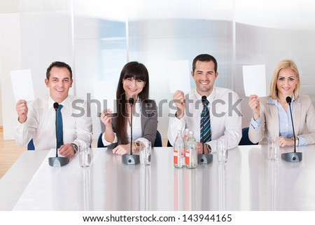Group Of Business People In Holding Voting Paper - stock photo