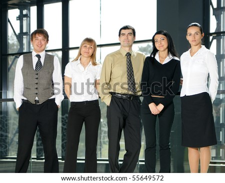 Group of business people in modern interior