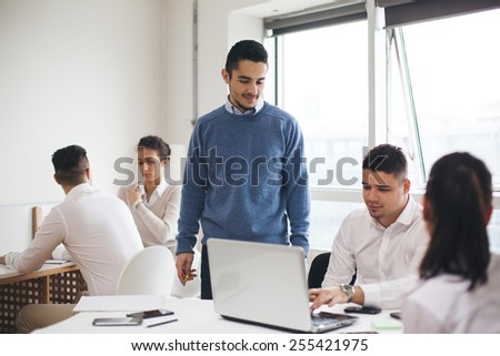 Group of business people in office building - stock photo