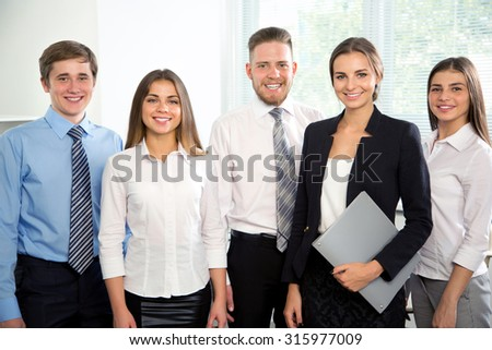 Group of business people in office. Businessteam. - stock photo