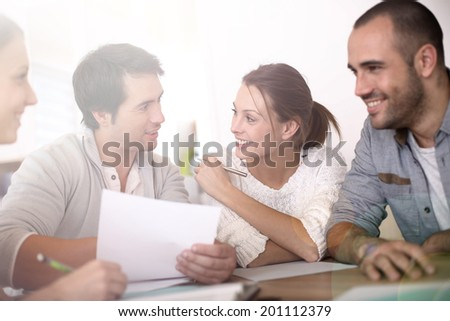 Group of business people in office working on project - stock photo