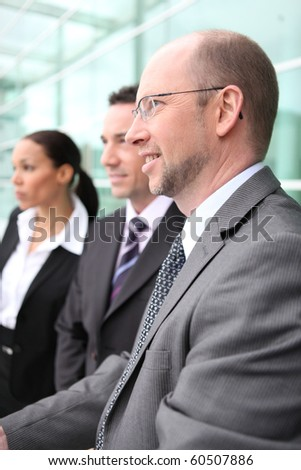 Group of business people in the lobby - stock photo