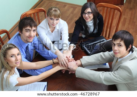 Group of business people interacting together at the office with a success. - stock photo