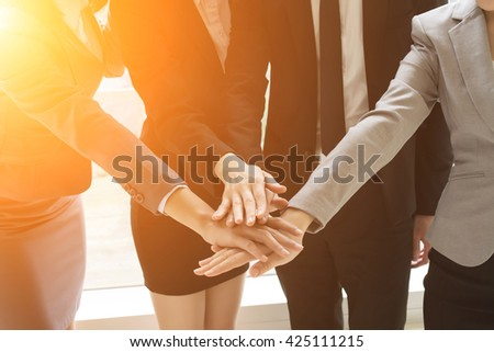 Group of business people joining hand together for making a deal - stock photo