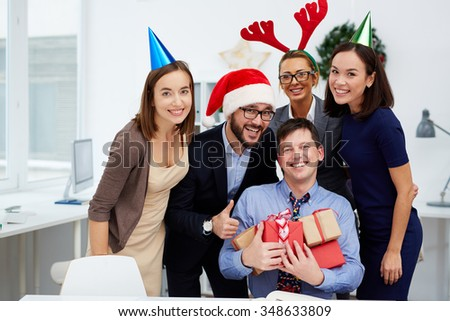 Group of business people looking at camera in office on Christmas day
