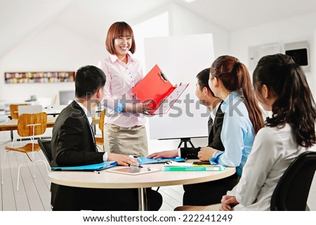 Group of business people looking at the graph on flowchart - stock photo