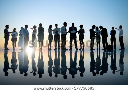 Group of Business People Meeting with Sunset - stock photo