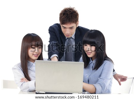 Group of business people on a laptop in an office - stock photo