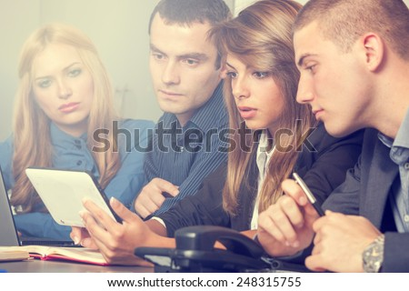 Group of business people on a meeting - stock photo