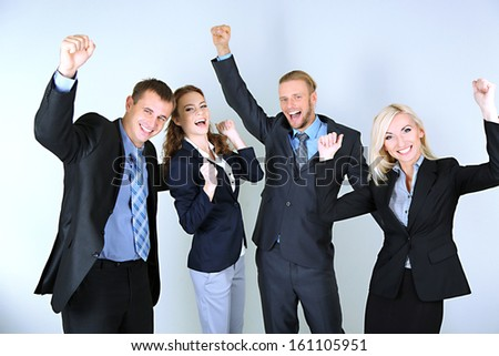Group of business people on gray background