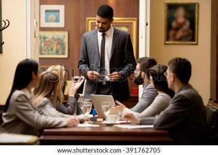 group of business people or lawyers - meeting in an office - stock photo