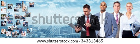 Group of business people over blue office background. - stock photo