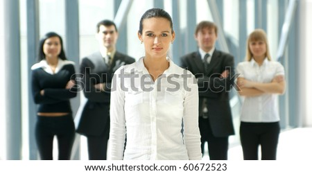 Group of business people over futuristic background - stock photo
