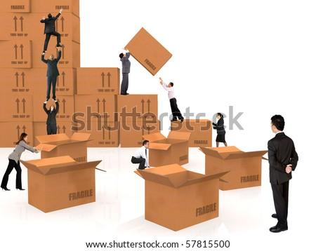 group of business people piling up boxes - isolated over a white background - stock photo