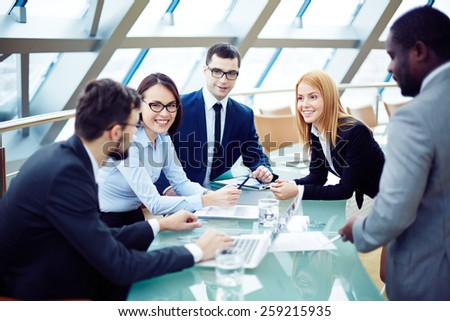 Group of business people planning together - stock photo