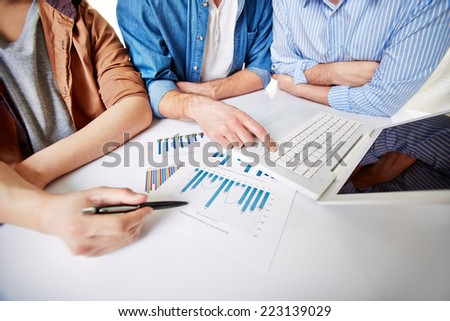 Group of business people preparing detailed project report