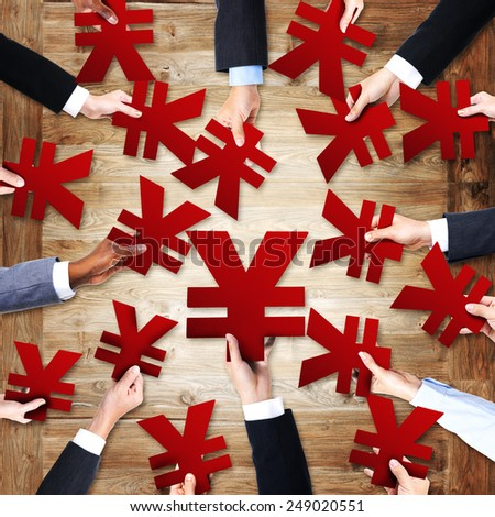 Group of Business People's Hands Holding Yen Symbols - stock photo