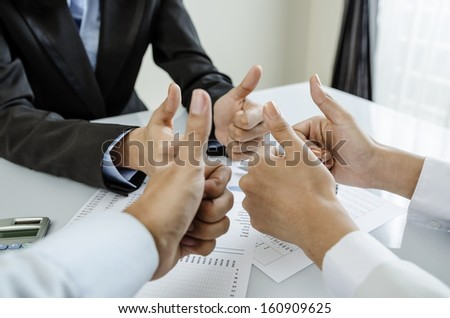 Group of business people show thumb up - stock photo