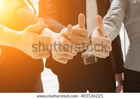 Group of business people showing thumb up gesture - stock photo